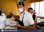 waiter in mask